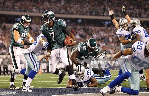 Quarterback Michael Vick of the Philadelphia Eagles runs for a touchdown against the Dallas Cowboys at Cowboys Stadium on December 12 2010 in...