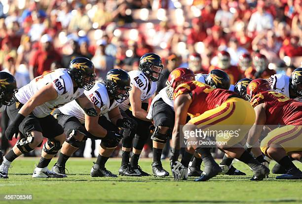 Quarterback Mike Bercovici of the Arizona State Sun Devils takes the snap in the first quarter during the game against the USC Trojans at Los Angeles...