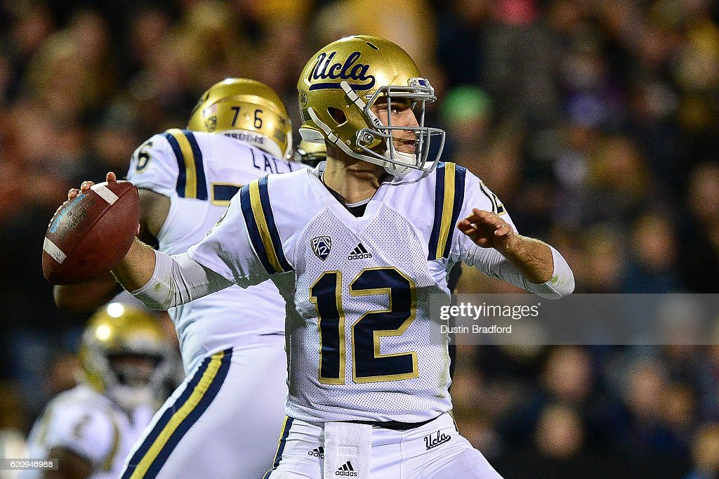 Quarterback Mike Fafaul #12 of the UCLA Bruins passes against the Colorado Buffaloes at Folsom Field on November 3, 2016 in Boulder, Colorado.