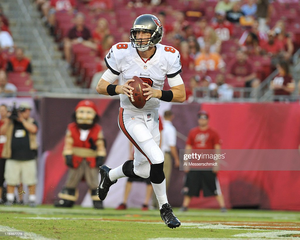 Quarterback Mike Glennon #8 of the Tampa Bay Buccaneers sets to pass against the Washington Redskins August 29, 2013 at Raymond James Stadium in Tampa, Florida.