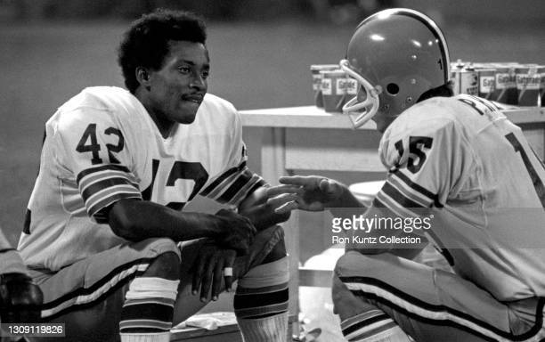 Quarterback Mike Phipps and wide receiver Paul Warfield of the Cleveland Browns talk on the sideline during a preseason game against the New England...