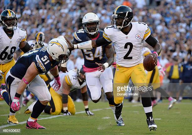 Quarterback Mike Vick of the Pittsburgh Steelers is pursued by outside linebacker Kyle Emanuel of the San Diego Chargers at Qualcomm Stadium on...