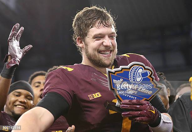 Quarterback Mitch Leidner of the Minnesota Golden Gophers celebrates a bowl win and the Most Valuable Player of the Game over Central Michigan...