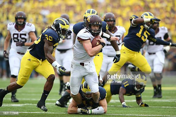 Quarterback Mitch Leinder of the Minnesota Golden Gophers runs for a first down during the second quarter of the game against the Michigan Wolverines...