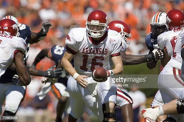Quarterback Mitch Mustain of the Arkansas Razorbacks hands off the ball against the Auburn Tigers at Jordan-Hare Stadium on October 7, 2006 in...