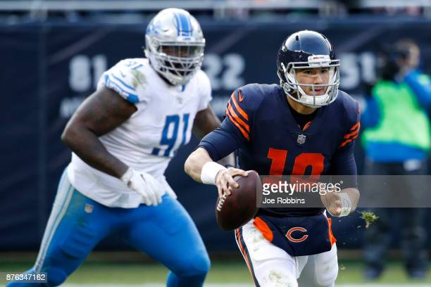 Quarterback Mitch Trubisky of the Chicago Bears carries the football in the fourth quarter against the Detroit Lions at Soldier Field on November 19...