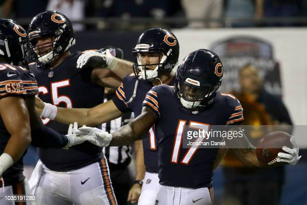 Quarterback Mitchell Trubisky and Anthony Miller of the Chicago Bears celebrate after Miller scored a touchdown against the Seattle Seahawks in the...