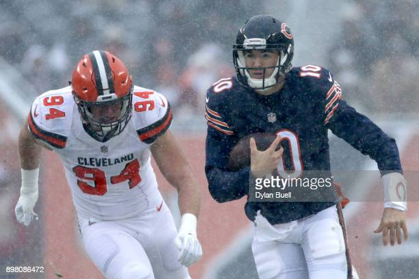 Quarterback Mitchell Trubisky of the Chicago Bears carries the football against Carl Nassib of the Cleveland Browns in the first quarter at Soldier...