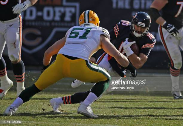 Quarterback Mitchell Trubisky of the Chicago Bears carries the football against Kyler Fackrell of the Green Bay Packers in the second quarter at...