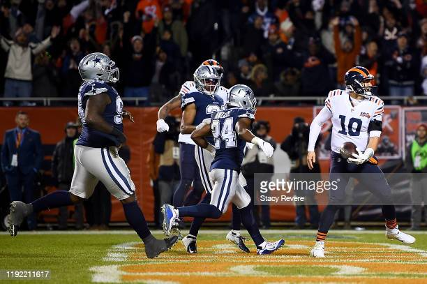 Quarterback Mitchell Trubisky of the Chicago Bears celebrates rushing for a touchdown over the defense of the Dallas Cowboys in the fourth quarter of...