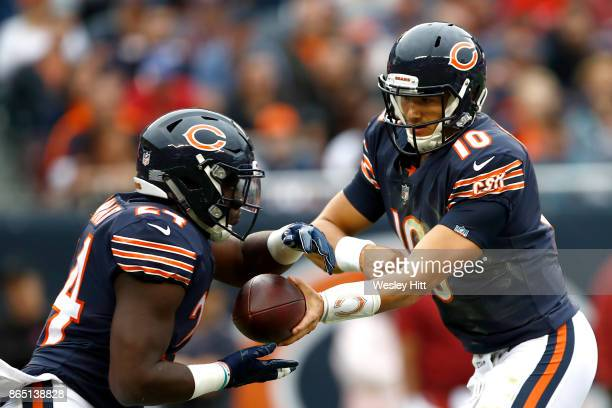 Quarterback Mitchell Trubisky of the Chicago Bears hands the football off to Jordan Howard during the game against the Carolina Panthers at Soldier...