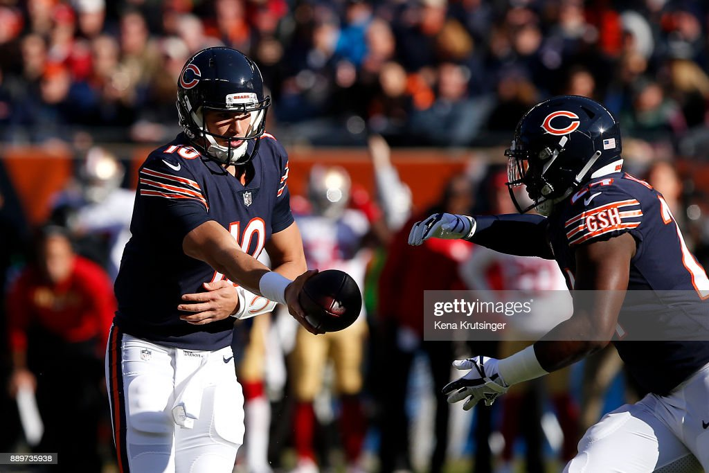 Quarterback Mitchell Trubisky #10 of the Chicago Bears hands the football off to Jordan Howard #24 in the first quarter against the San Francisco 49ers at Soldier Field on December 3, 2017 in Chicago, Illinois. The San Francisco 49ers defeated the Chicago Bears 15-14.