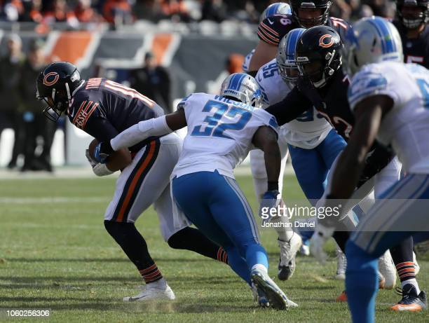 Quarterback Mitchell Trubisky of the Chicago Bears is held by Tavon Wilson of the Detroit Lions in the second quarter at Soldier Field on November 11...