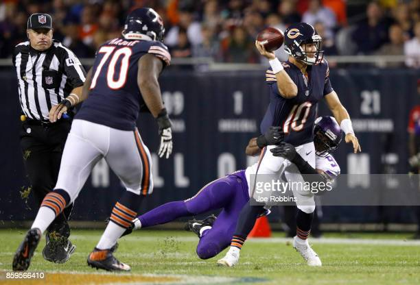 Quarterback Mitchell Trubisky of the Chicago Bears is hit by Danielle Hunter of the Minnesota Vikings in the third quarter at Soldier Field on...