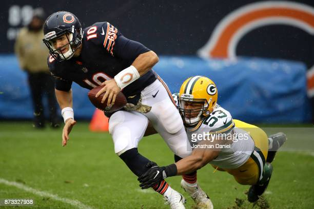Quarterback Mitchell Trubisky of the Chicago Bears is sacked by Nick Perry of the Green Bay Packers in the third quarter at Soldier Field on November...