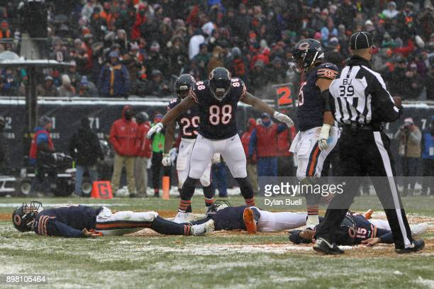 Quarterback Mitchell Trubisky of the Chicago Bears makes a snow angel with teammates after scoring against the Cleveland Browns in the third quarter...