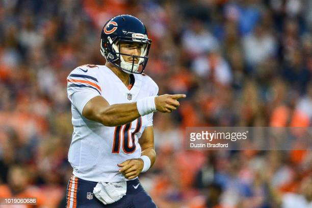 Quarterback Mitchell Trubisky of the Chicago Bears points to the bench area to celebrate after throwing a second quarter touchdown pass against the...