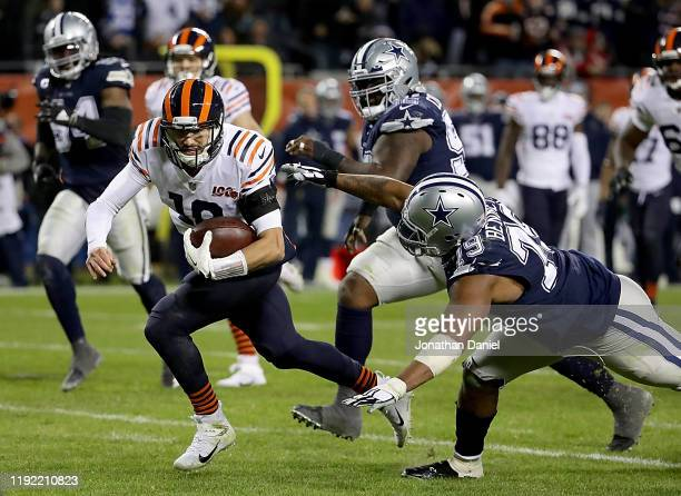Quarterback Mitchell Trubisky of the Chicago Bears rushes for a touchdown over the defense of defensive end Michael Bennett of the Dallas Cowboys in...