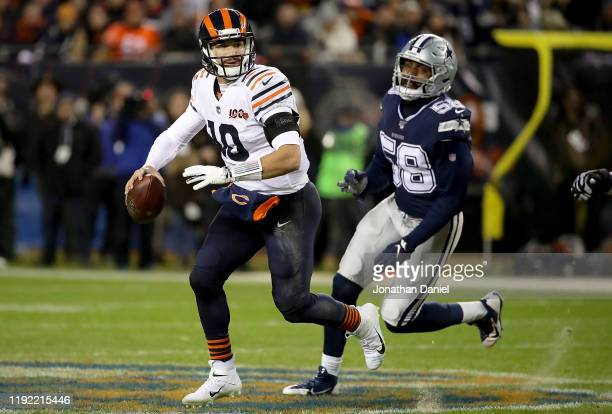 Quarterback Mitchell Trubisky of the Chicago Bears scrambles against defensive end Robert Quinn of the Dallas Cowboys during the game at Soldier...