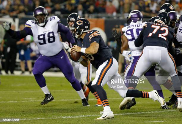 Quarterback Mitchell Trubisky of the Chicago Bears scrambles out of the pocket in the first quarter against the Minnesota Vikings at Soldier Field on...