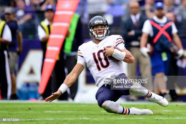Quarterback Mitchell Trubisky of the Chicago Bears slides in the second quarter against the Baltimore Ravens at MT Bank Stadium on October 15 2017 in...