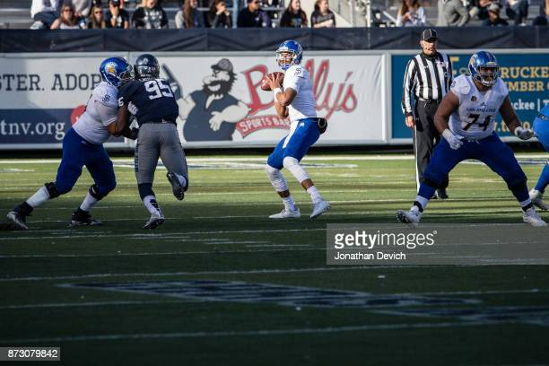 Quarterback Montel Aaron of the San Jose State Spartans looks for a receiver as the offensive line battles the Nevada Wolf Pack at Mackay Stadium on...