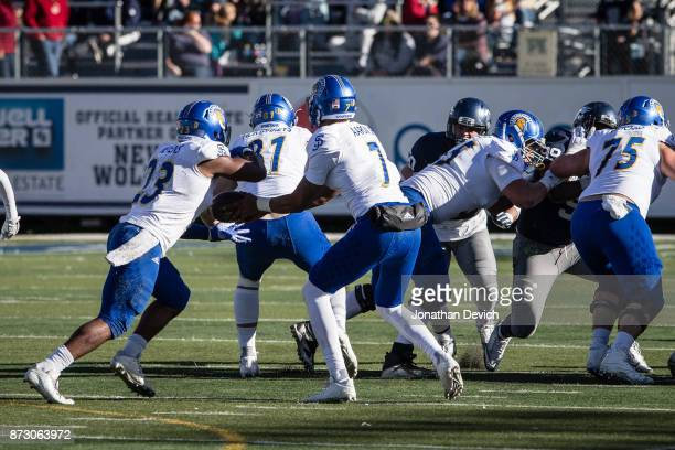 Quarterback Montel Aaron of the San Jose State Spartans passes the ball to running back Tyler Nevens of the San Jose State Spartans to run against...