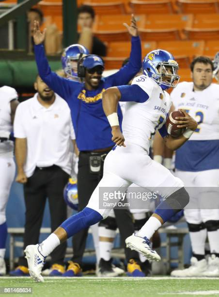 Quarterback Montel Aaron of the San Jose State Spartans runs down the sideline during the first quarter of the game against the Hawaii Rainbow...