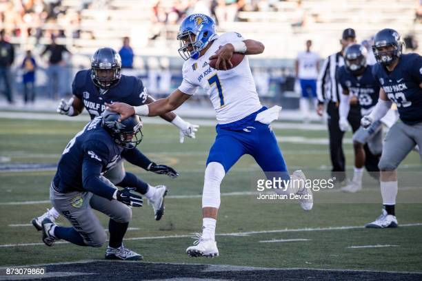 Quarterback Montel Aaron of the San Jose State Spartans runs the ball against the Nevada Wolf Pack defense at Mackay Stadium on November 11 2017 in...