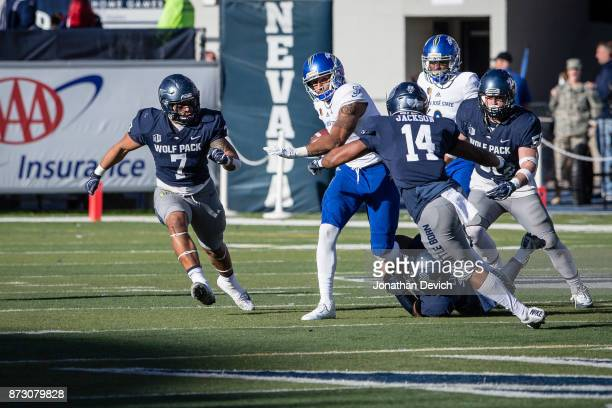 Quarterback Montel Aaron of the San Jose State Spartans tries to get away from defensive back Berdale Robins of the Nevada Wolf Pack before being...