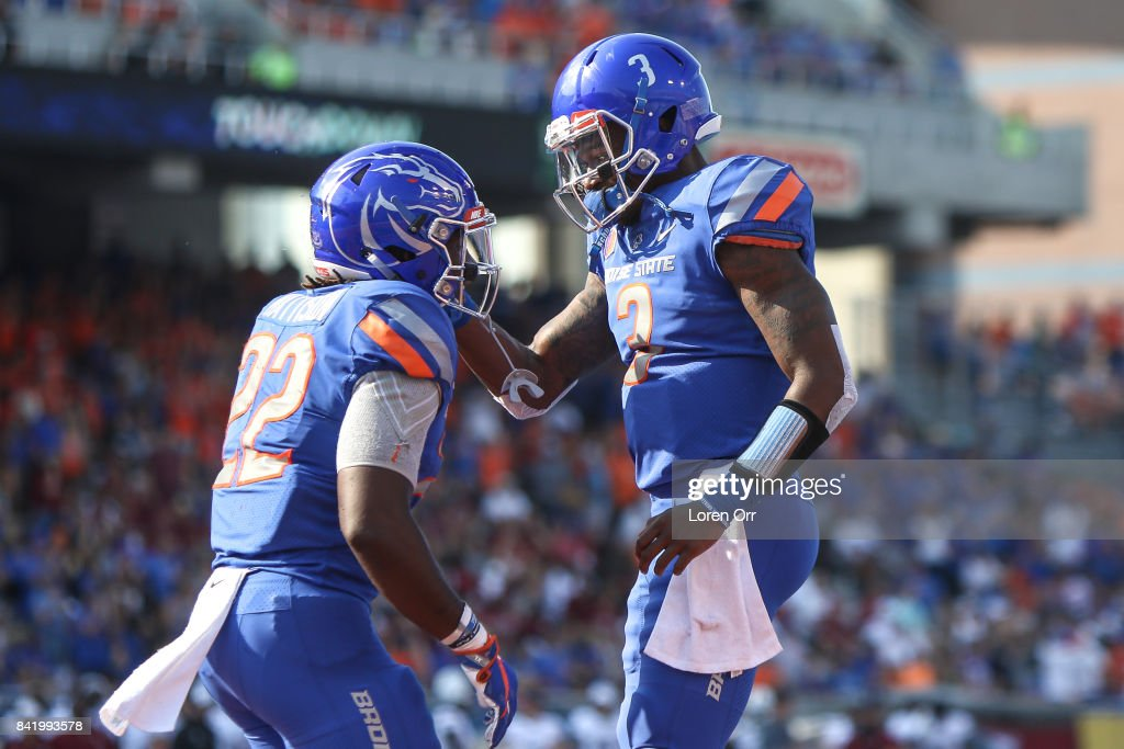 Quarterback Montell Cozart #3 and running back Alexander Mattison #22 of the Boise State Broncos celebrate a touchdown during second half action against the Boise State Broncos on September 2, 2017 at Albertsons Stadium in Boise, Idaho. Boise State won the game 24-13.