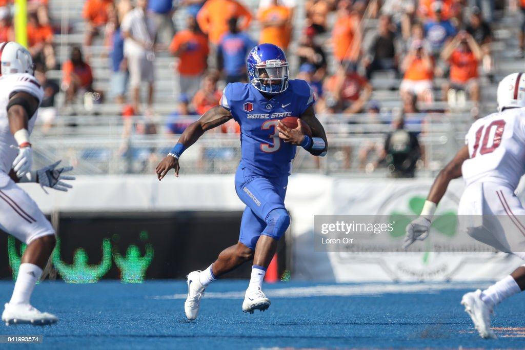 Quarterback Montell Cozart #3 of the Boise State Broncos scrambles during second half action against the Troy Trojans on September 2, 2017 at Albertsons Stadium in Boise, Idaho. Boise State won the game 24-13.