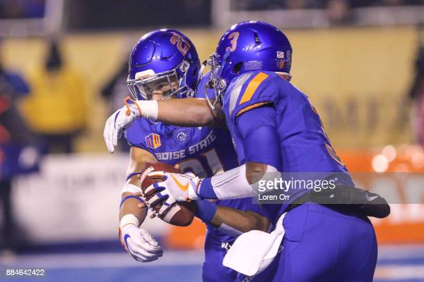 Quarterback Montell Cozart prepares to hand the ball to running back Ryan Wolpin of the Boise State Broncos during second half action in the Mountain...