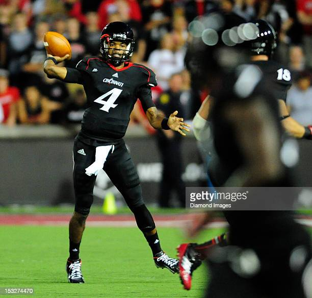 Quarterback Munchie Leqaux of the Cincinnati Bearcats throws a pass during a game with the Delaware State Hornets at Nippert Stadium in Cincinnati...