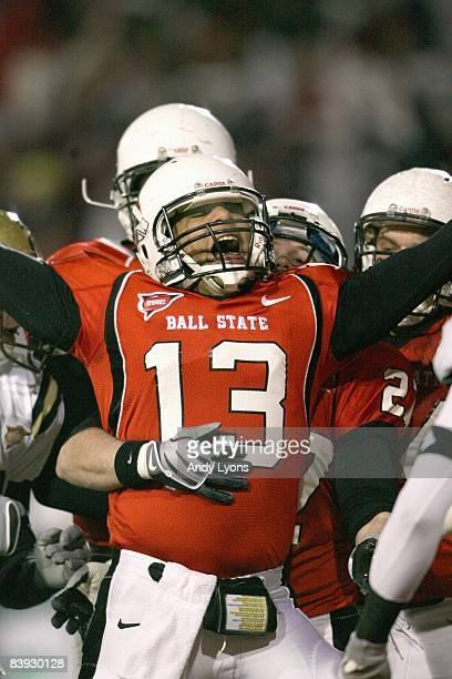 Quarterback Nate Davis of the Ball State Cardinals celebrates on the field during the MAC game against the Western Michigan Broncos at Scheumann...