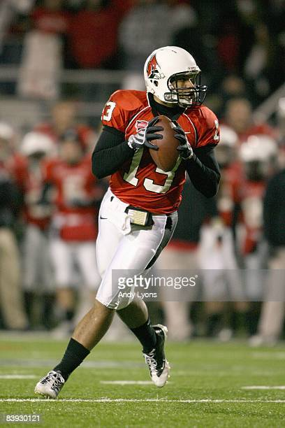 Quarterback Nate Davis of the Ball State Cardinals drops back to pass the ball during the MAC game against the Western Michigan Broncos at Scheumann...