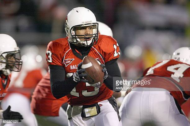 Quarterback Nate Davis of the Ball State Cardinals drops back with the ball during the MAC game against the Western Michigan Broncos at Scheumann...