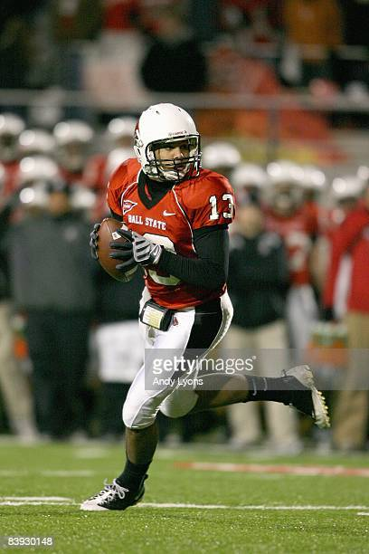 Quarterback Nate Davis of the Ball State Cardinals runs as he looks to pass the ball during the MAC game against the Western Michigan Broncos at...