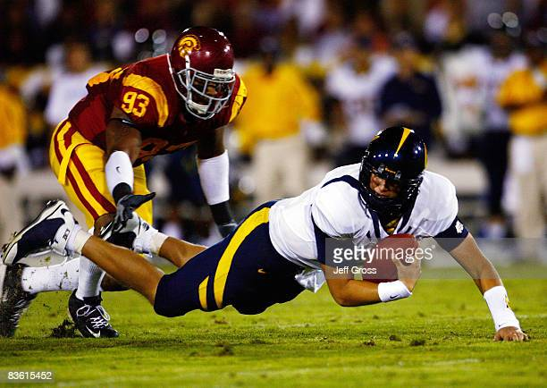 Quarterback Nate Longshore of the California Golden Bears is sacked by Everson Griffen of the USC Trojans during the second quarter at the Memorial...