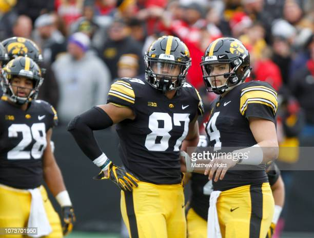 Quarterback Nate Stanley and tight end Noah Fant of the Iowa Hawkeyes during a break in the action in the first half against the Nebraska Cornhuskers...