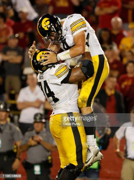 Quarterback Nate Stanley of the Iowa Hawkeyes celebrates with teammate offensive lineman Tristan Wirfs of the Iowa Hawkeyes after scoring a touchdown...
