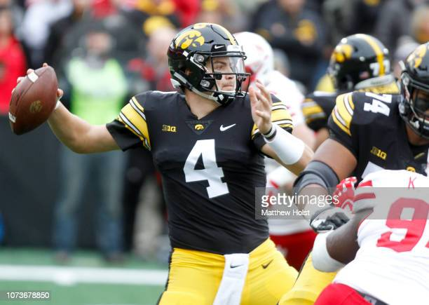 Quarterback Nate Stanley of the Iowa Hawkeyes drops back to throw a pass in the first half against the Nebraska Cornhuskers on November 23 2018 at...