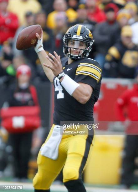 Quarterback Nate Stanley of the Iowa Hawkeyes drops back to throw a pass in the second half against the Nebraska Cornhuskers on November 23 2018 at...