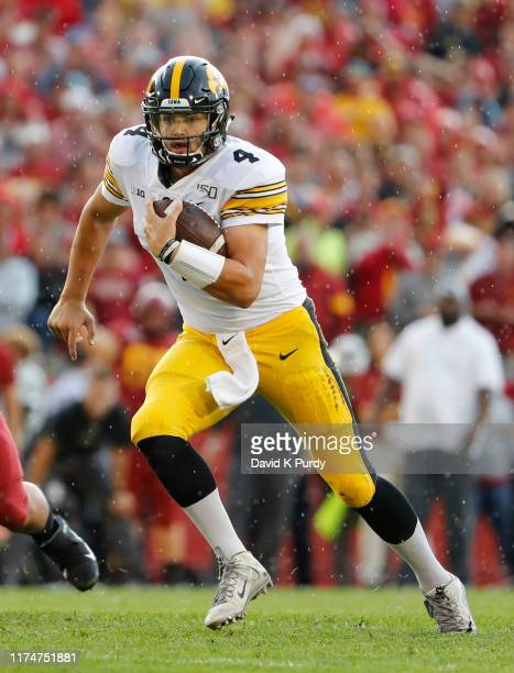 Quarterback Nate Stanley of the Iowa Hawkeyes scrambles for yards in the first half of play at Jack Trice Stadium on September 14 2019 in Ames Iowa...