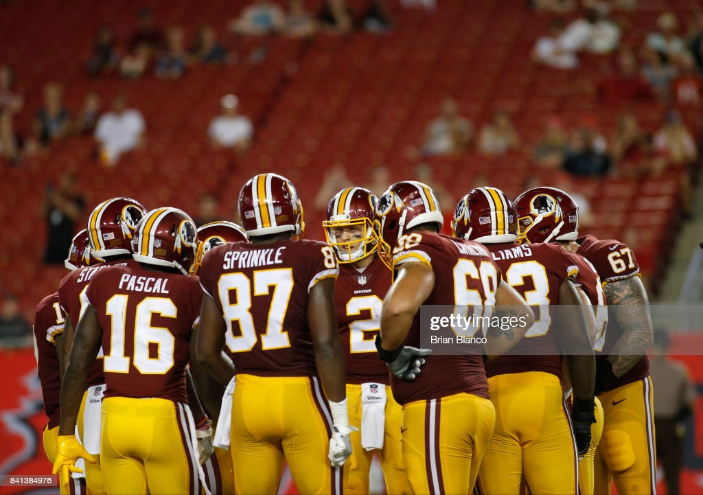 Quarterback Nate Sudfeld #2 of the Washington Redskins huddles the offense during the fourth quarter of an NFL preseason football game against the Tampa Bay Buccaneers on August 31, 2017 at Raymond James Stadium in Tampa, Florida.