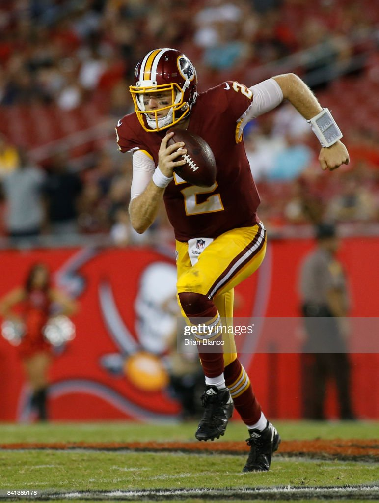 Quarterback Nate Sudfeld #2 of the Washington Redskins runs for several yards during the fourth quarter of an NFL preseason football game against the Tampa Bay Buccaneers on August 31, 2017 at Raymond James Stadium in Tampa, Florida.
