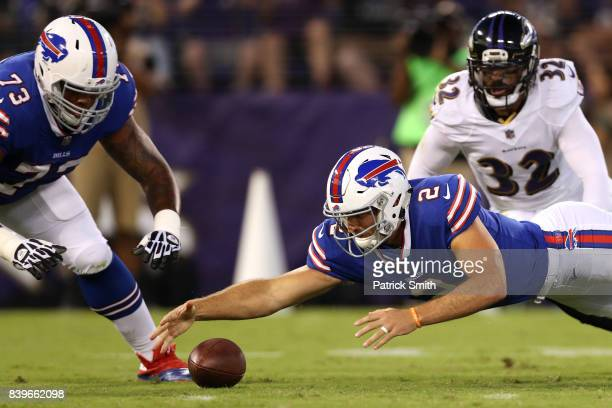 Quarterback Nathan Peterman of the Buffalo Bills fumbles against the Baltimore Ravens in the first half during a preseason game at MT Bank Stadium on...