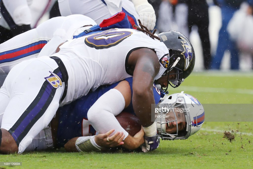 Quarterback Nathan Peterman #2 of the Buffalo Bills is tackled by Za'Darius Smith #90 of the Baltimore Ravens in the first quarter at M&T Bank Stadium on September 9, 2018 in Baltimore, Maryland.