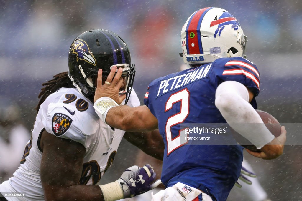 Quarterback Nathan Peterman #2 of the Buffalo Bills stiff arms linebacker Za'Darius Smith #90 of the Baltimore Ravens in the second quarter against the Baltimore Ravens at M&T Bank Stadium on September 9, 2018 in Baltimore, Maryland.