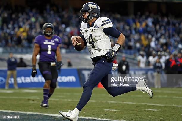 Quarterback Nathan Peterman of the Pittsburgh Panthers scores a touchdown during the New Era Pinstripe Bowl against the Northwestern Wildcats at...
